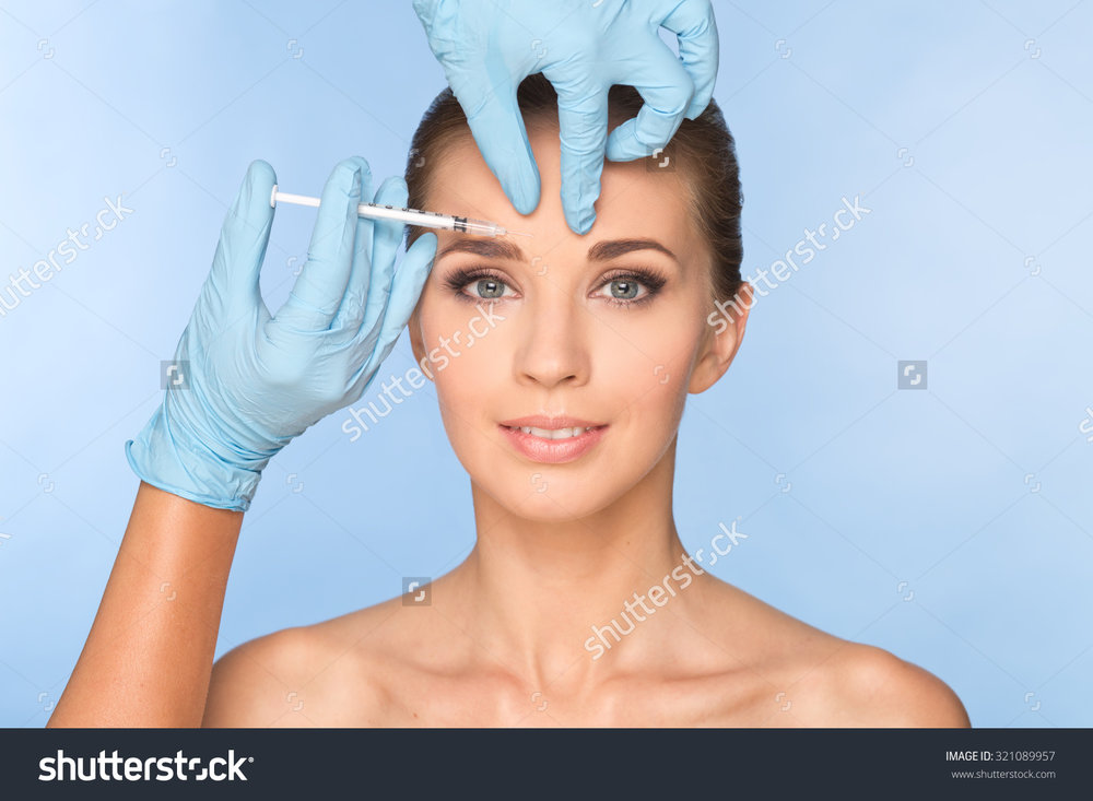 stock-photo-attractive-young-woman-gets-cosmetic-injection-doctors-hands-making-an-injection-in-face-beauty-321089957.jpg