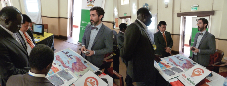 Geo Gecko displaying some of the previous work of Geo Gecko staff to the Ugandan Minister for Disaster Preparedness, the Dean of the Makarere School of Public Health, the Principal Innovations Director, Makarere and the Disaster Risk Management Advisor to the UN Development Programme/Office of the Prime Minister.