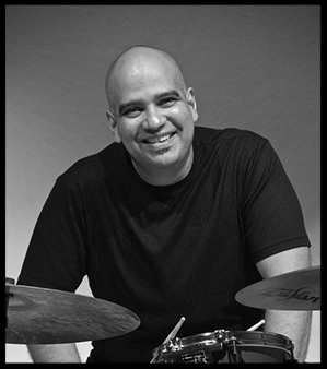 Joselo+on+drums+smiling+B&W.jpg