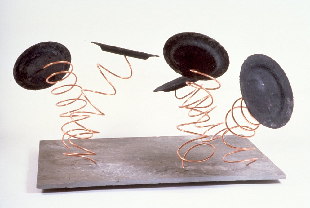 Found Objects, Paper Mache, Acrylic Paint, Copper Tubing on Slate Base  35 x 24in.  1988