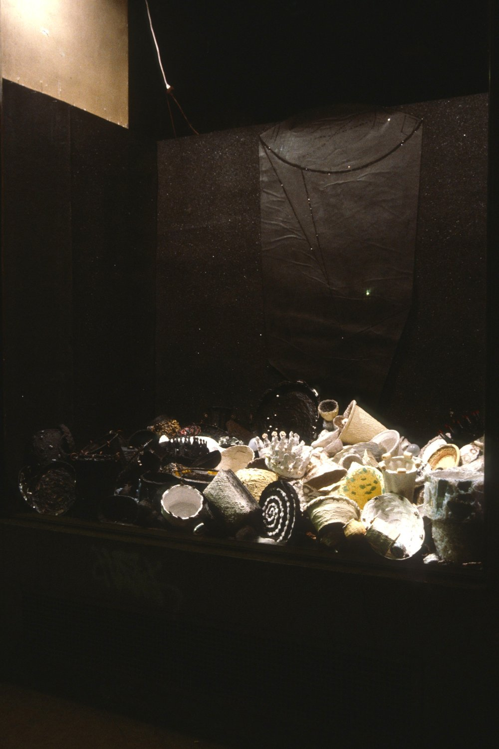 Installation at Windows on White, 1985  found objects, silicone, acrylic paint, caulk, glass