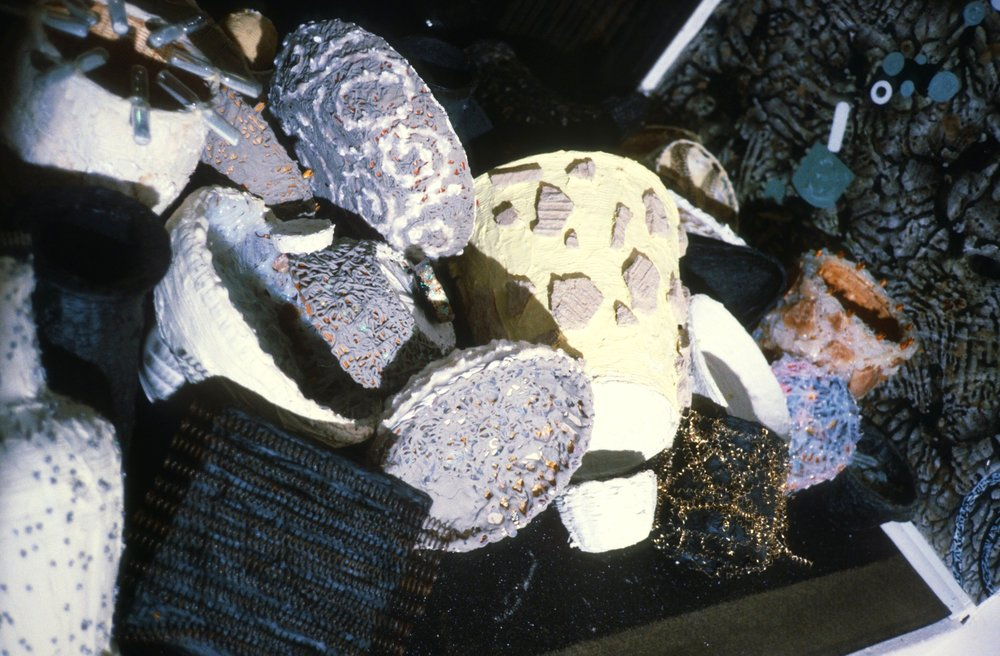 Window Installation at Avenue B Gallery, 1987  acrylic paint, mica, found objects, silicone, paper, caulk, glass  Detal View*
