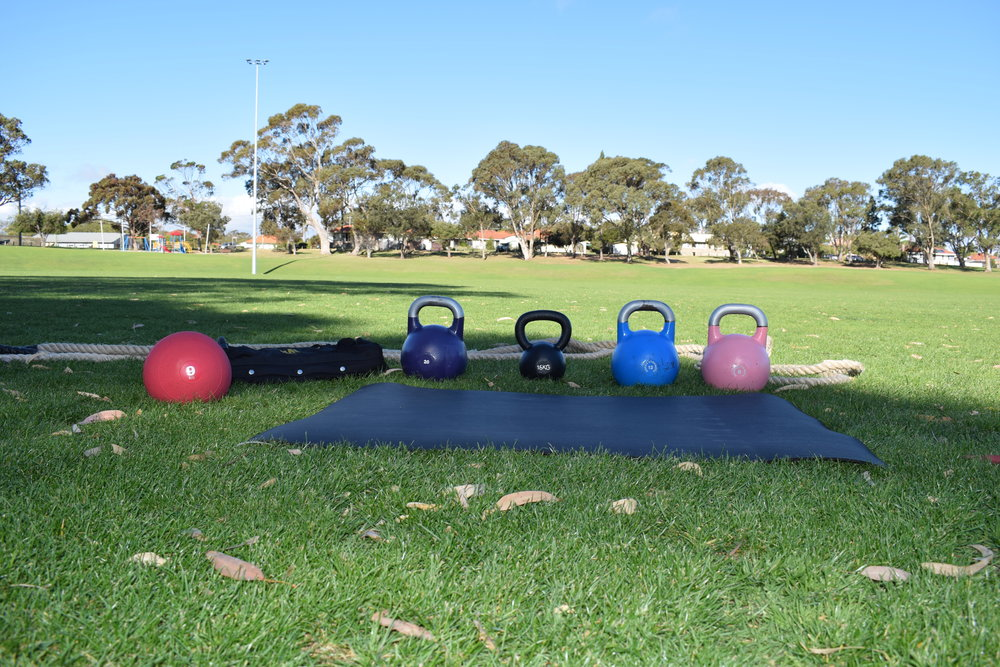 Just a few implements you could use.   From L to R   Slam Ball, Sandbag, Kettlebells and rope