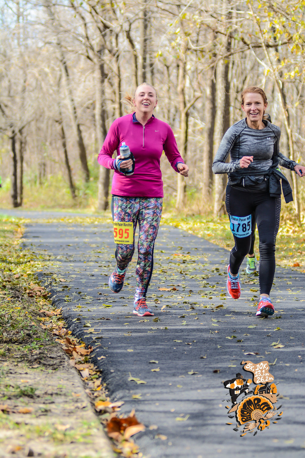 The course was a double out and back. This is on our way in, round two. Me, on the left. The best running partner in the world, on the right. Smile through the pain, baby! Photo: Mile 90 Photography