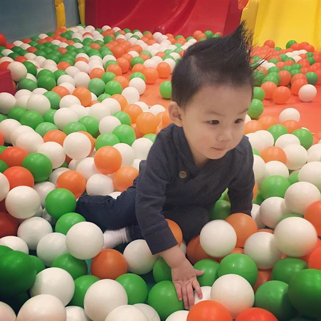 """Children see magic because they look for it."" - Christopher Moore . . . . . #ouiouibebe #carefree #playtime #ballpit #momofboys #childhood #fun #laughs"