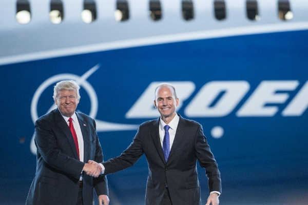 Boeing Chairman & CEO Dennis Muilenburg greets President Trump at the unveiling of the 787-10 widebody jetliner in South Carolina on February 17. (Photo by Sean Rayford/Getty Images)