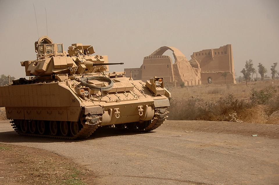 A Bradley fighting vehicle in Iraq during the closing days of the U.S. military occupation. The Bradley is being upgraded and modified to provide the Army with better armored protection, mobility and firepower, but the pace of improvement is hampered by scarce funding. (U.S. Army photo by Sgt. Timothy Kingston) (www.army.mil)