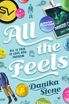 The cover of  All The Feels , by Danika Stone. The title is surrounded by pins and convention badges.