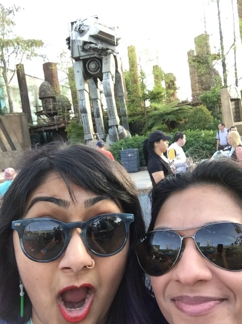 Preeti (L) and Swapna (R) take a selfie in front of a life-size AT-AT.