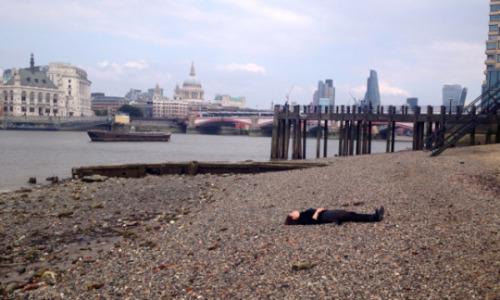 Elizabeth lying on the beach, as in  Sherlock.