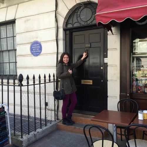 Elizabeth knocking on the door of 221B Baker Street.