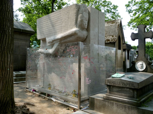 Oscar Wilde's grave, with art deco angels adorning it and many kisses on the clear barrier between it and the rest of the graveyard.