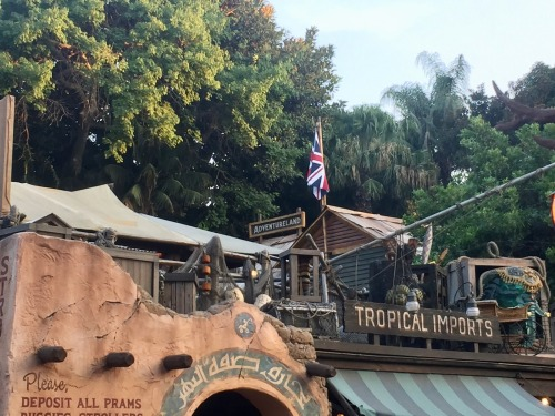 "An image from Disneyland of an Adventureland fort with the British flag and the words ""Tropical Imports."""