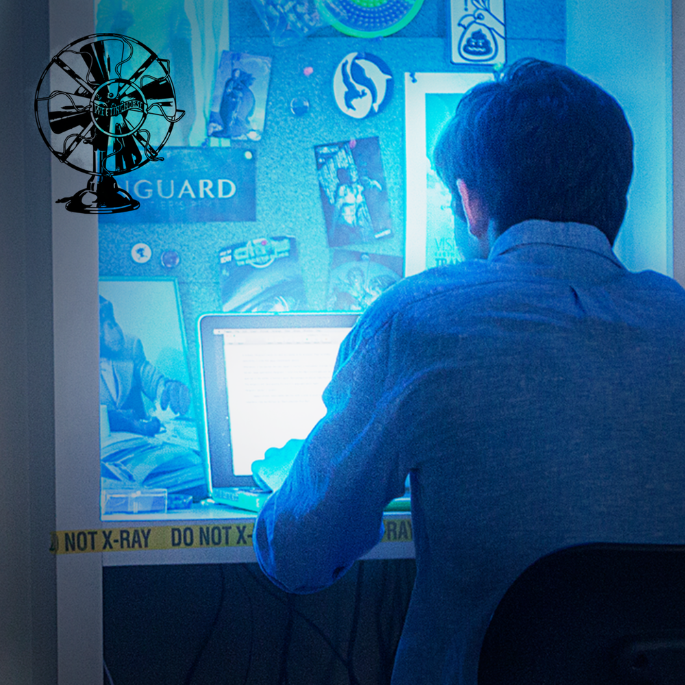 Episode 18's cover: a young man hunches over a computer, late at night.