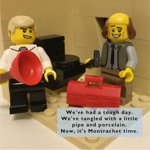 "Lego Frasier says, ""We've had a tough day. We've tangled with a little pipe and porcelain. Now it's Montrachet time."""