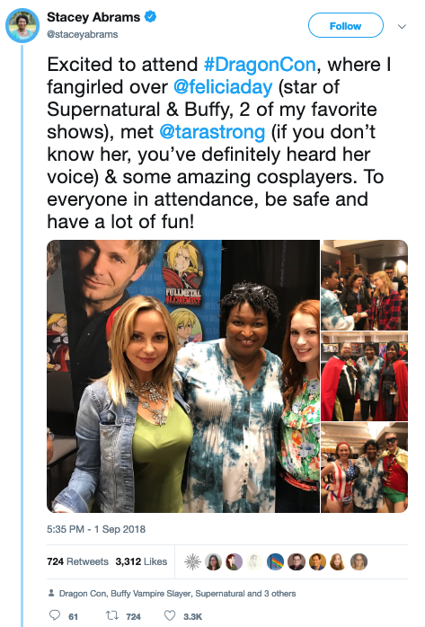 """Stacey Abrams tweets: """"Excited to attend #DragonCon, where I fangirled over @feliciaday (star of Supernatural & Buffy, 2 of my favorite shows), met @tarastrong (if you don't know her, you've definitely heard her voice) & some amazing cosplayers. To everyone in attendance, be safe and have a lot of fun!"""" The tweet is accompanied by pictures of Abrams with various congoers, including Felicia Day."""