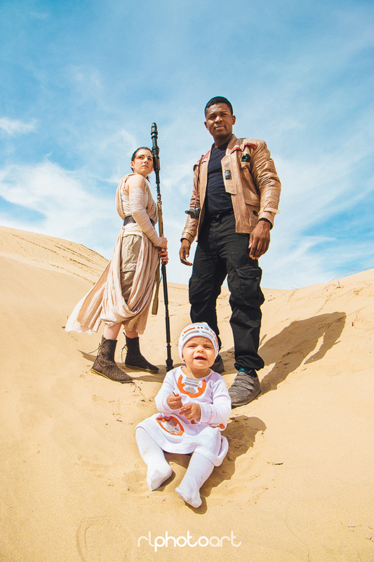 """Cosplayers portraying Rey, Finn and """"BaBy-8."""""""