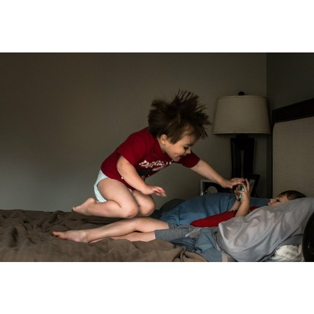 When your older brother won't pay attention to you because he's playing video games, you jump on him. 😂 . . .  #clickinmoms #dearphotographer  #the_sugar_jar #thebloomforum #childhoodunplugged #letthekids #candidchildhood #dearestviewfinder  #cameramama  #kidsforreal #our_everyday_moments #littlefierceones #thisismotherhood #magicofchildhood #embracingtheeveryday #thesincerestoryteller #fearlessandframed #documentyourdays #thedocumentarymovement #atlantaparent #atlantamom #atlantadocumentaryphotographer #shamoftheperfect #wildandbravelittles #bufordphotographer #redefinethefamilyphoto #lovegwinnett #familyphotojournalism #thebeautifulreal