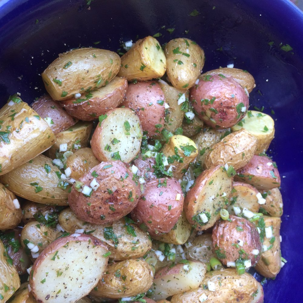 Homegrown fingerling potatoes and parsley on display in this light but incredibly flavorful potato salad.