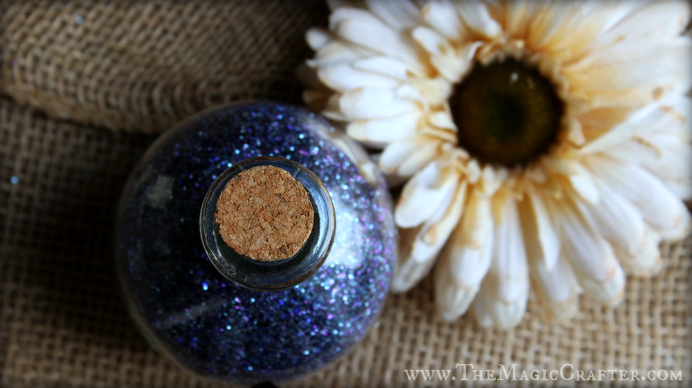 Black Magic fairy dust looking pretty all bottled up in a potion bottle.