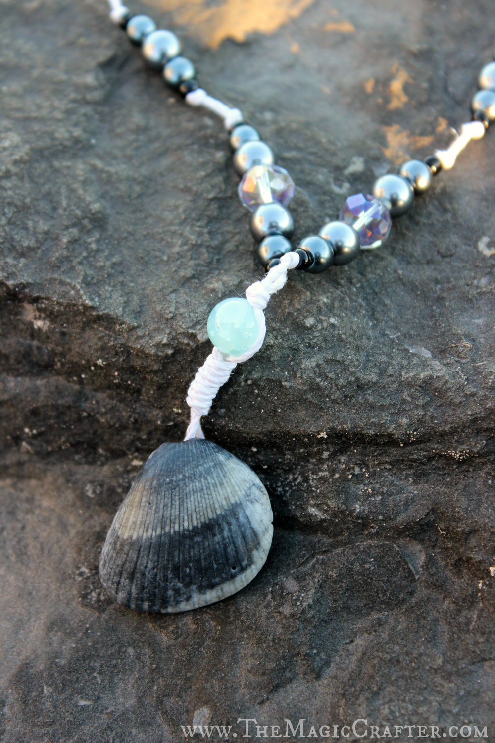 Just like the other one, this sea shell necklace is reversible too! I really love the color of this shell. :)