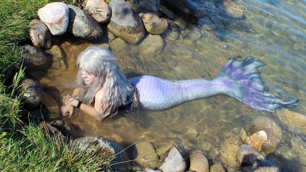 Mermaid Phantom, one of Michigan's real mermaids, is resting on a rock near Lake Leelanau. She is soaking up the sun and enjoying one of the last warm days of the year.