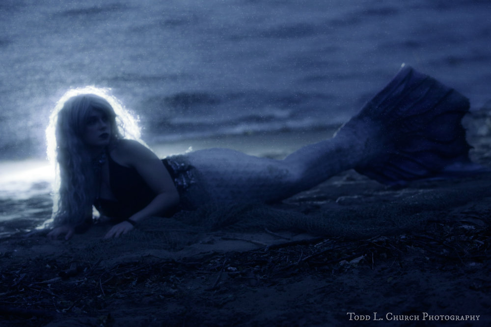 Professional Mermaid, Phantom, can be seen here in the light of the moon. This photograph was taken on a rainy night in Northern Michigan by Todd L. Church.  Photo by: Todd L. Church Photography, Model: Mermaid Phantom of www.themagiccrafter.com