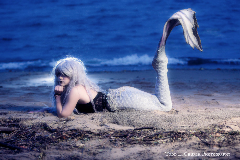Mermaids in the Moonlight: Mermaid Phantom is a Professional Mermaid from Traverse City, Michigan. Her ghostly tail and her ghostly mane give her her namesake. Mermaid Phantom can most be seen in the summer, although she can be spotted on the beach on certain rainy nights throughout the year! Photo by: Todd L. Church Photography, Model: Mermaid Phantom of www.themagiccrafter.com