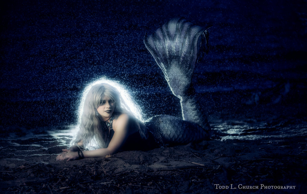 Here is another picture of Mermaid Phantom, a Professional Mermaid, bathing in the rain. This photo turned out a bit darker than the rest, but it looks quite nice and eerie! ;P  Photo by: Todd L. Church Photography, Model: Mermaid Phantom of www.themagiccrafter.com