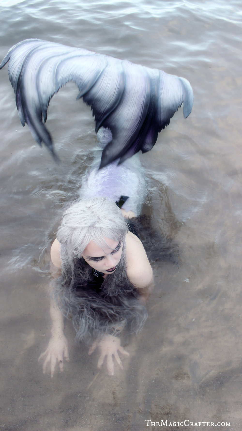 Mermaid Images: Pictures of a creepy Goth mermaid in the water. This is Mermaid Phantom, one of Michigan's only real live mermaids. She is a professional mermaid who lives and works in the Traverse City area. Despite her odd looks, she is actually quite great with children and does not usually dress so scary. :)