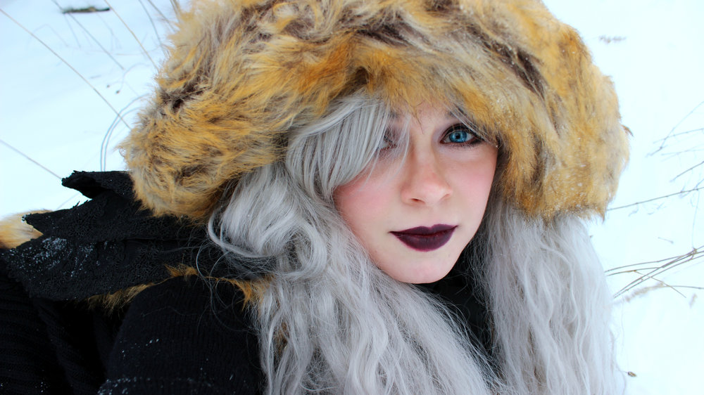 "Here's a closeup picture of me in my ""Snow Queen"" outfit. My makeup was most likely frozen to my face... 🤔😅 The furry hood of my Gothic cloak kept my head pretty warm when it actually stayed on my head though!"