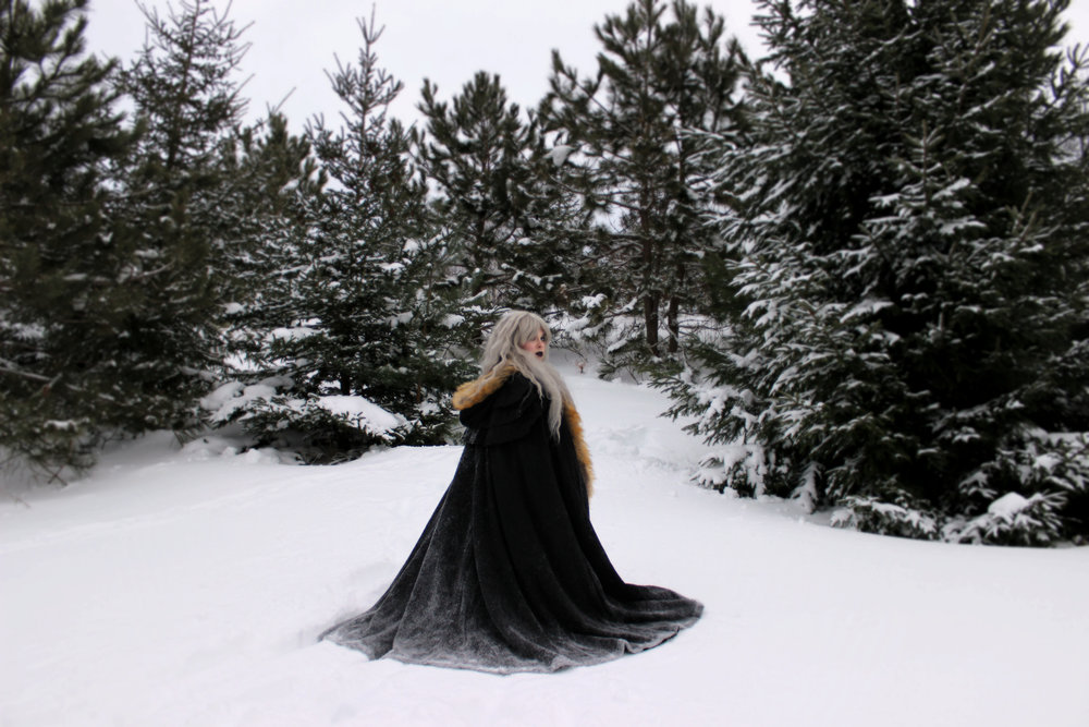 "Here's a full-body picture of my ""Ice Queen"" outfit. The cape/cloak was bought from Devil Night UK. It is by the brand ""Punk Rave."" I am TOTALLY in love with it!! The way the snow climbs up the side of it to create an ombre look is so beautiful! ♥ And when I spin it around in circles, the snow comes flying off and makes me look like I have magical snow powers! 😘"