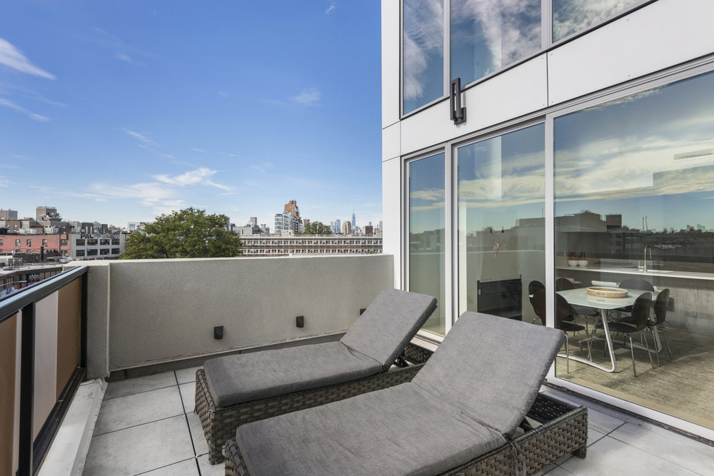 Greenpoint Apartment Building with Outdoor Deck Access.