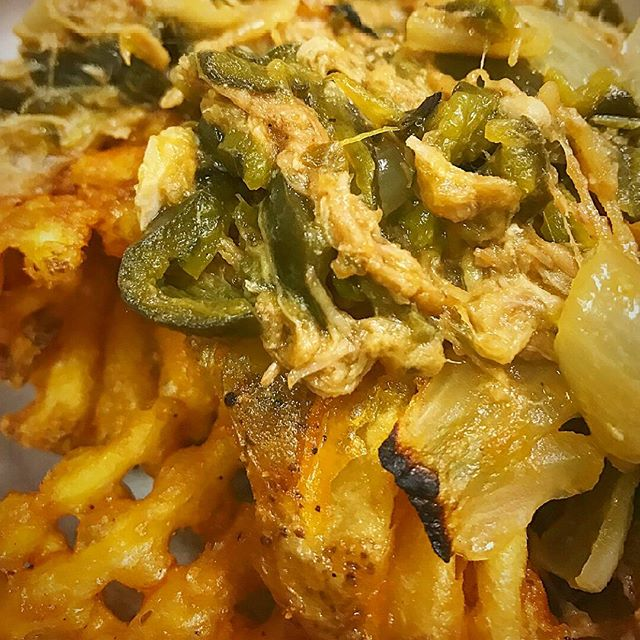Waffle fries making sweet sweet music w our green pork chili.... MERCY  #wafflefries #notpizza #nothandmade #realfood #fitspo #thinspo #treatyoself #modern food #hangovercure #deepfriedisdeeplove