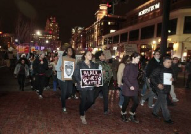 Demonstrators march to the State House in downtown Providence, RI.