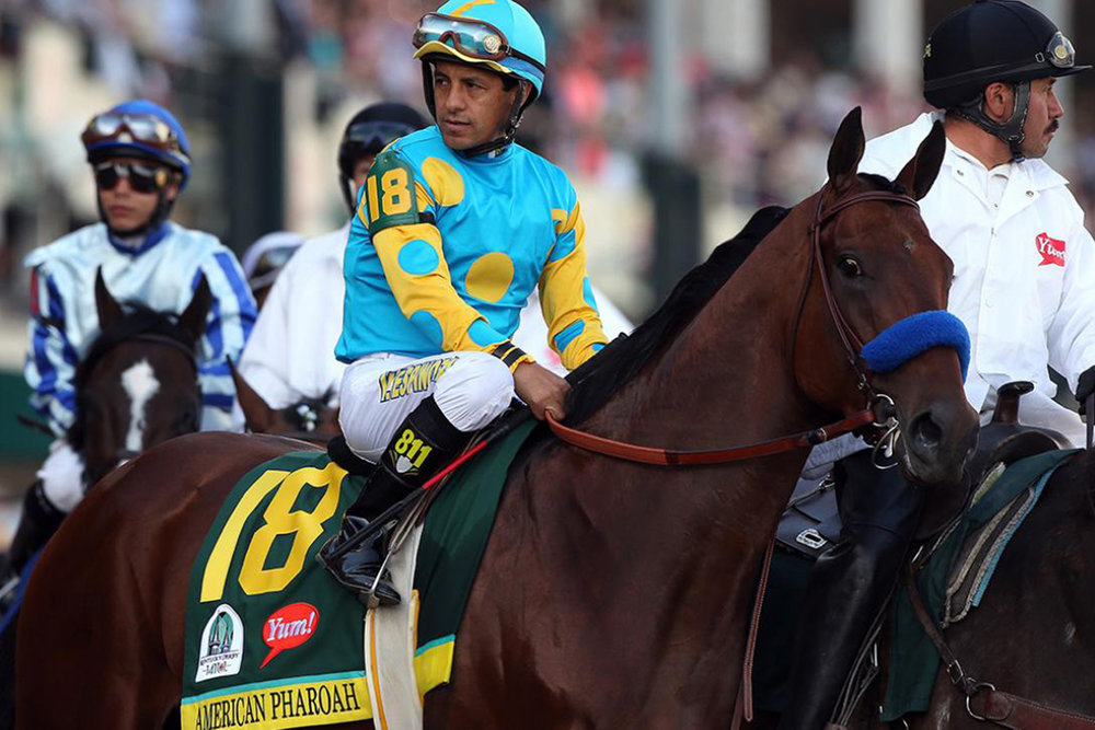 triple crown winner American pharoah with jockey victor espinoza at the kentucky derby in 2015