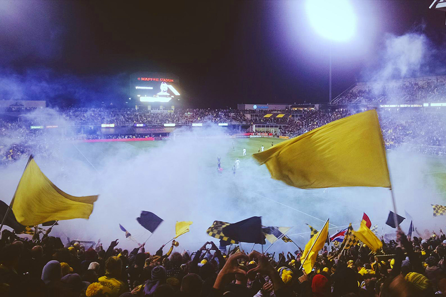 Stadium crowd yellow flags.jpg