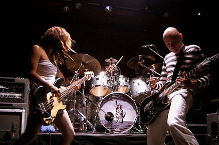Performing with the Smashing Pumpkins.