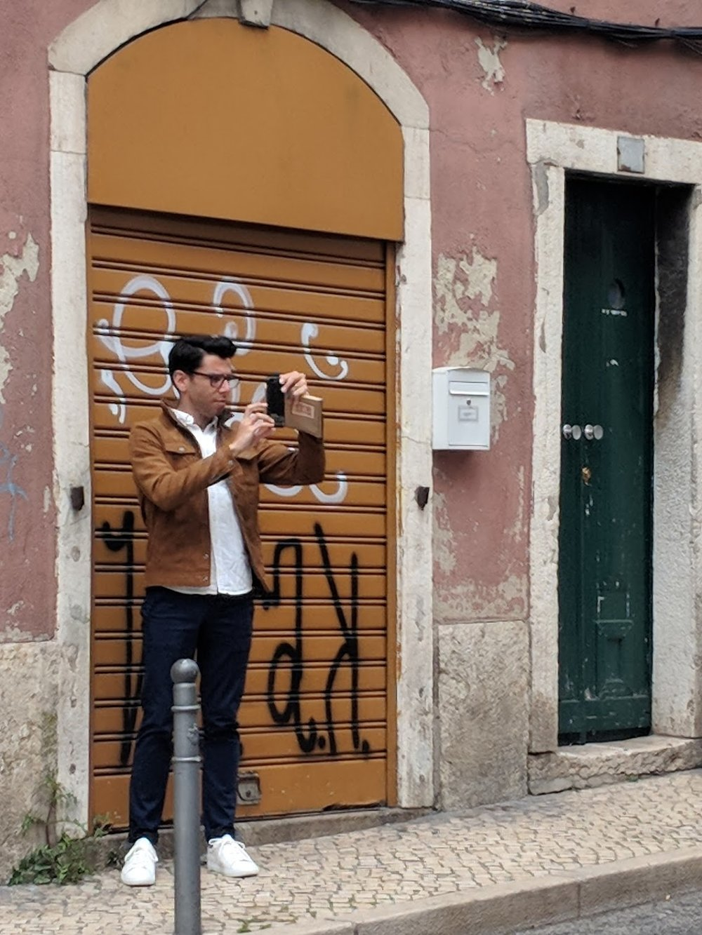 Designer taking photos of Lisbon Azulejo Buildings