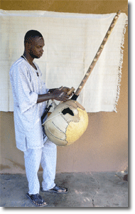 "Lazi began as a musician, playing several traditional instruments. Music, he clarified, and the playing of certain instruments was synonymous with story-telling itself:    ""You learn that instrument, you learn the stories. This is an Instrument of talk."""