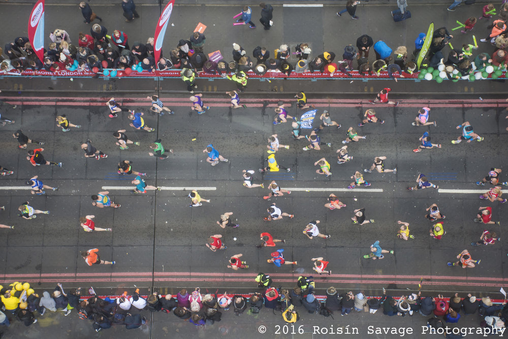 An aerial shot taken of the London Marathon runners passing over Tower Bridge, mile 20.