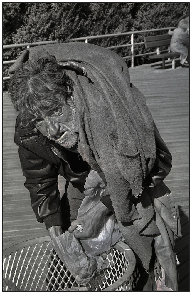 Desperate man searches trash for discarded food. Brighton Beach Boardwalk. Sept. 14, 1986