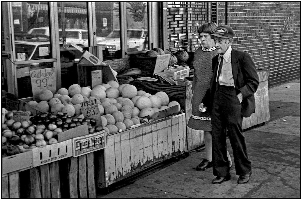 Korean War veteran, his partner, and cantaloupes at 99 cents each, New Jersey plum tomatoes at 59 cents/pound, water melon at 35 cents/pound, near Brighton Beach Avenue