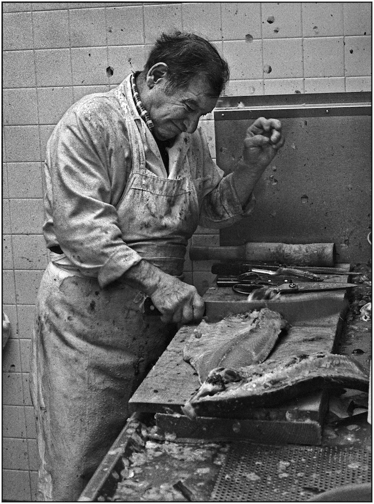 Fish store employee. Brighton Beach Avenue. March 20, 1987