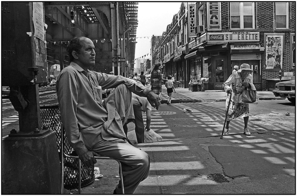 A merchant on Brighton Beach Avenue during a holiday, shopping lull. May 31, 1986