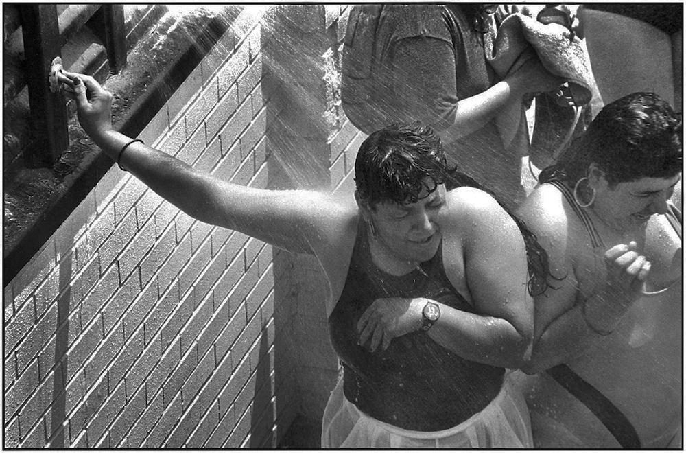An after-swim shower. Brighton Beach. July 4, 1990