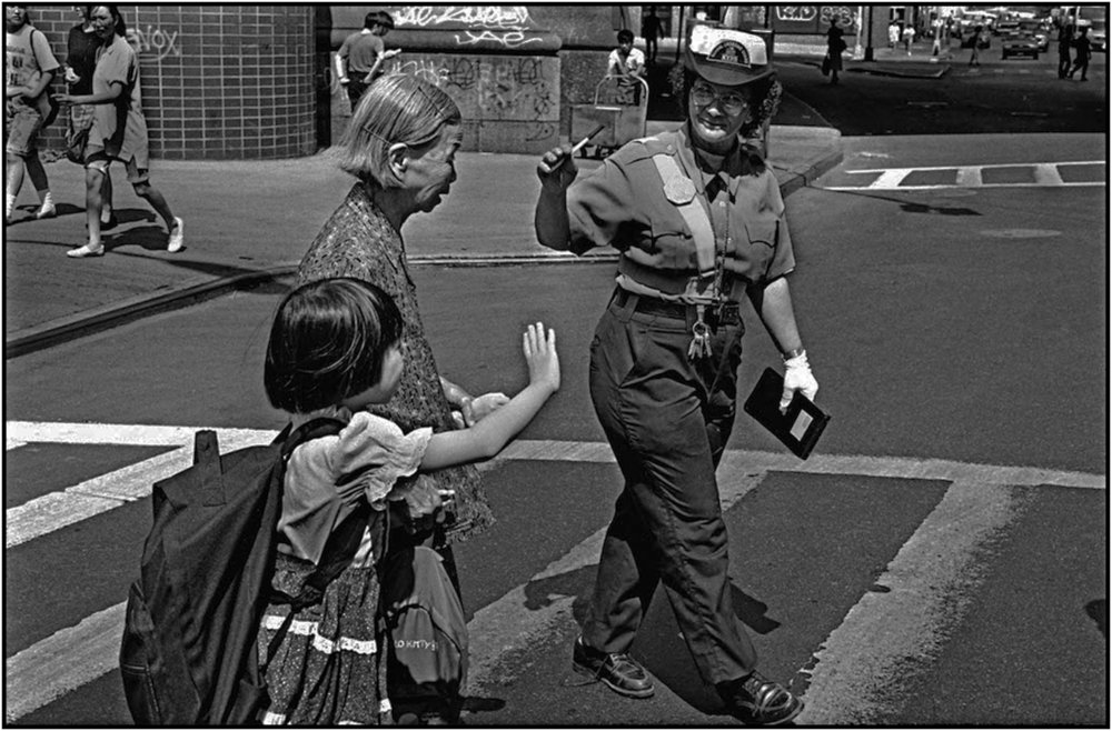Crossing Guard Elizabeth Cruz in Chinatown, Manhattan. 19--