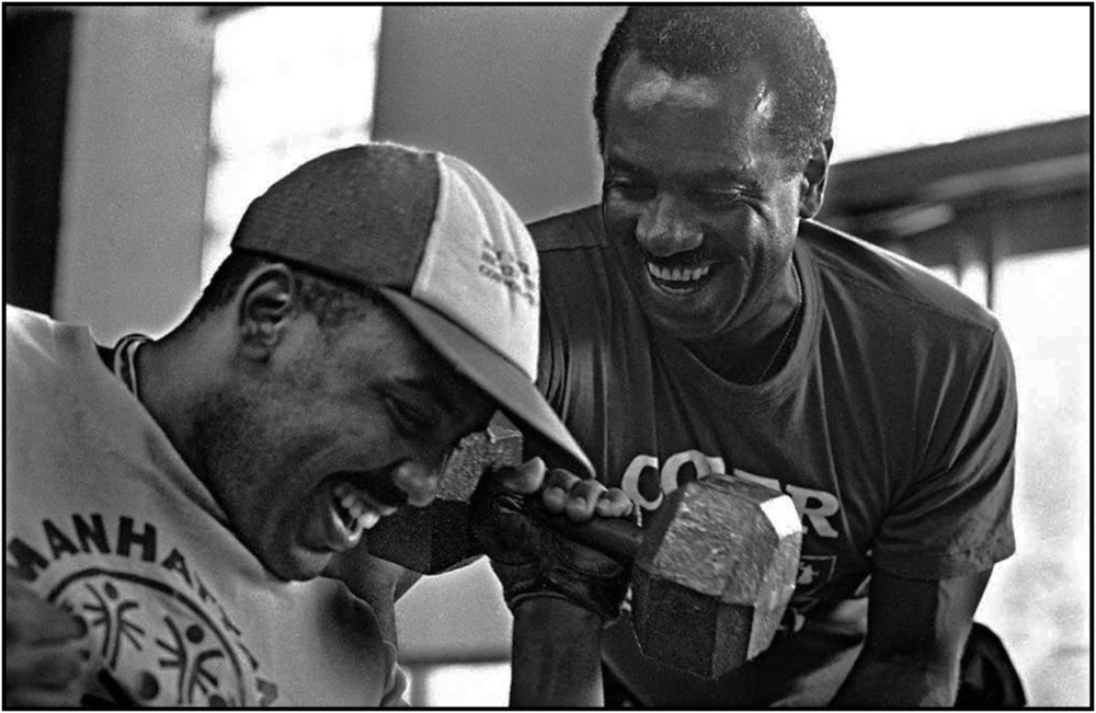 Special Olympics certified instructor and recreation worker, inspires disabled patient Juan Pimintel in wheelchair to lift weights at Coler Memorial Hospital on Roosevelt Island.  1992.