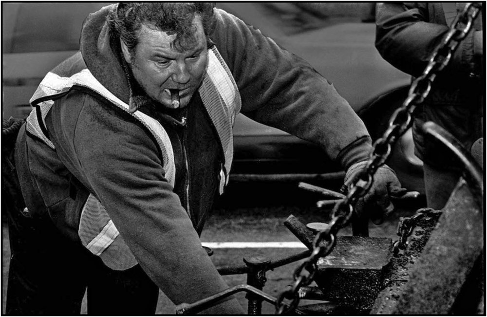 Highway Repairer works on a resurfacing gang on an extensive area of Central Park roadway in Manhattan. 1984.