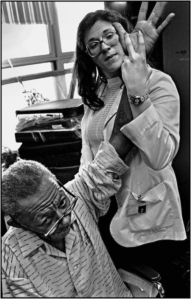 Occupational Therapist works with Maximo Palmer at Bellevue Hospital, Manhattan. 1981.
